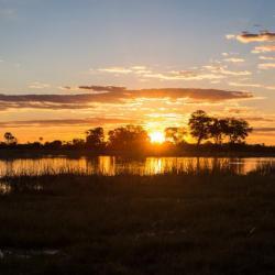 Sonnenuntergang im Okavango Delta, Botswana